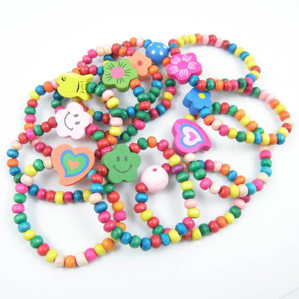 Süßigkeit-Farbenholz scherzt nettes Babyzubehör 10pcs / set A6466 der Armbandblumenregenbogenmädchenarmbandkindspielzeug-Entwerferzusätze