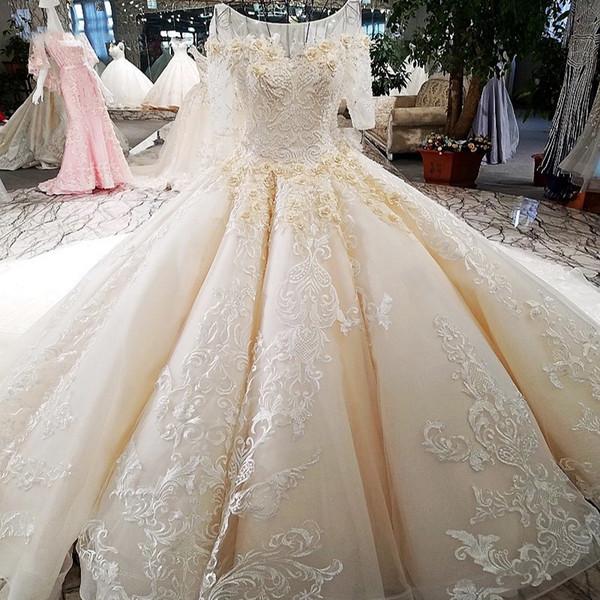 Elegante vestido de novia de media manga Vestido de bola con cordones Volver 3D Flor Champagne Vestidos de novia de novia de lujo con Royal Long Train