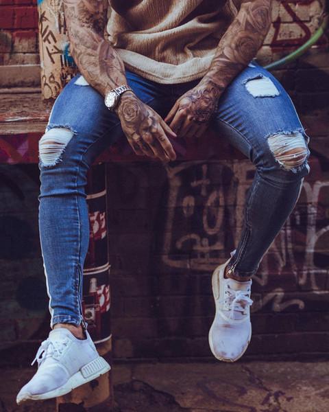 Pantalones para hombres Hip Hop Agujeros de roca Pantalones vaqueros rotos Biker Slim Fit Zipper Jean Pantalones desgastados