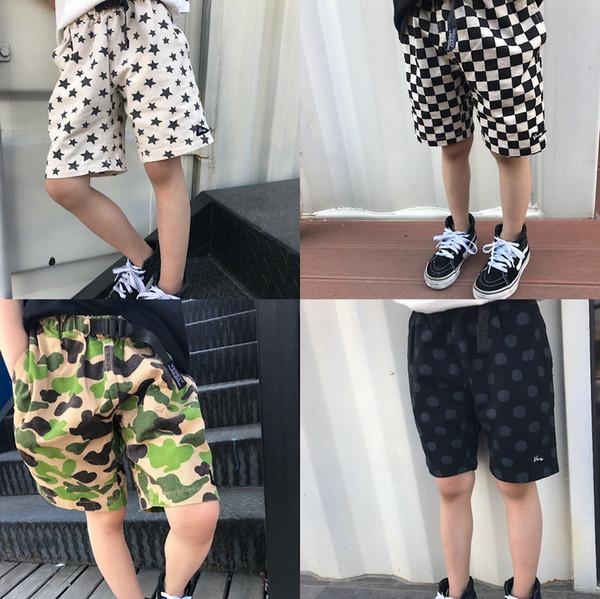 Spot 2019 nuevos pantalones de algodón para niños de la moda callejera japonesa Camuflaje infantil de verano con cinco pantalones impresos