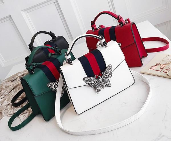 2019 New pattern. Leisure fashion handbag. Hardware butterfly. PU. Women\'s Bags. Small. Mini. White black. Shoulder Bags.Totes. handbags.