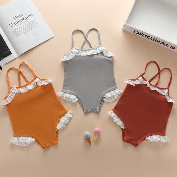 top popular Baby Girls Swimsuit Kids Suspender Bikini One-Pieces Child Falbala Ruffle Solid Swimwear Baby Summer Bathing Suit Fashion Beachwear PY635 2021