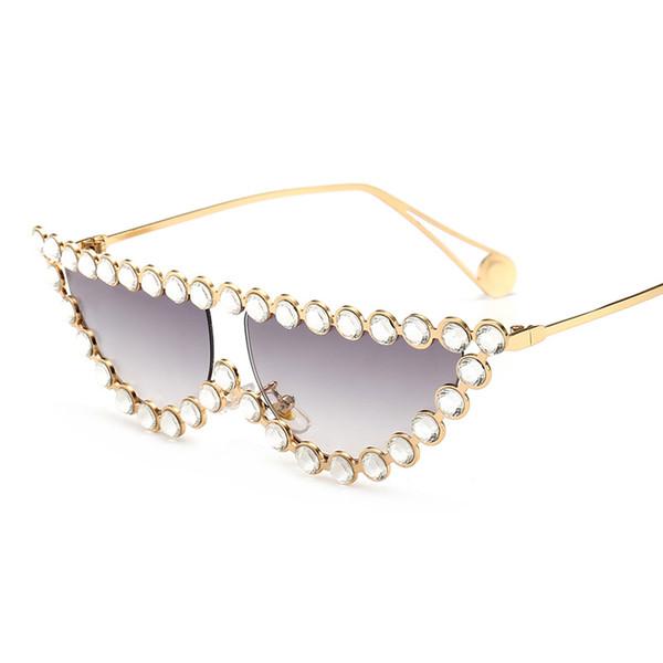 Novos óculos de sol incrustados de diamantes rua tiro explosões grande nome com os mesmos óculos de sol personalidade olho de gato óculos de sol