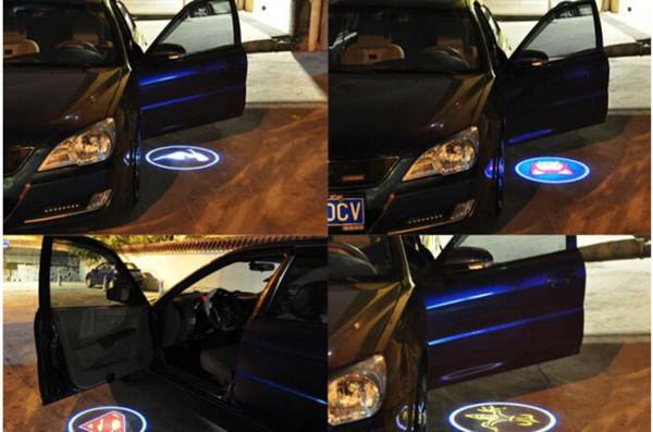 Al por mayor-inalámbrico puerta de coche logotipo de la luz del proyector del proyector llevó la luz de la sombra del fantasma de la lámpara para Audi Benz Nissan Mitsubishi Mazda VW Opel