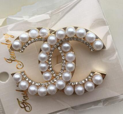 2019 2019 Famous Brooches Hot Crystal Rhinestone Letter Brooch Pin Hollow  Corsage Brooches Women Fashion Jewelry Costume Decoration From Yxl86, $4 53