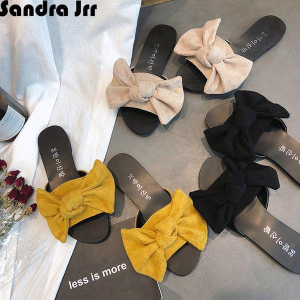 Sandra Jrr Mujer Zapatillas Faux Suede Bowknot Grande Arrastra Punta Abierta Talón plano Playa Femenina Sandalias Sandalias de Vacaciones Zapatos 2019 Más Nuevo