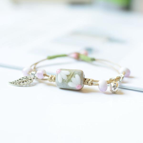 Bracelet en céramique original main exquis pincée fleur petit vent littéraire national frais version coréenne du bracelet féminin