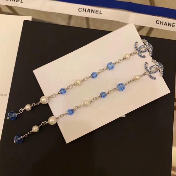 Top material de latón pendiente del encanto del pie derecho con diamante azul y la caída de la joyería pendiente prisionero de la perla para el regalo de bodas las mujeres PS5625A envío libre