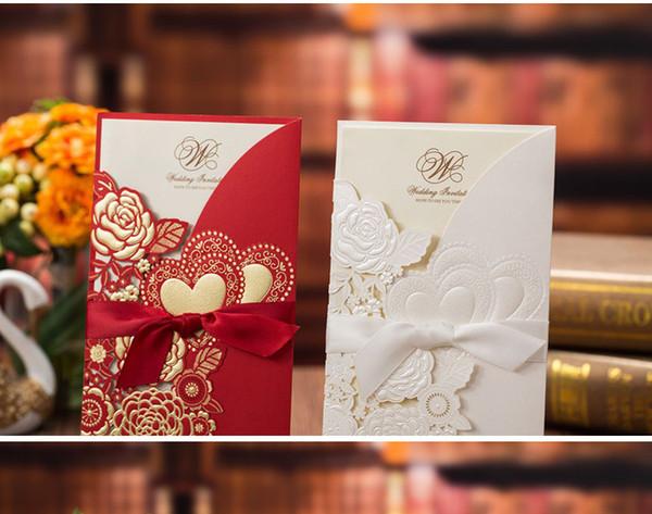 2019 Más nuevo chino Playa blanca Elegante hueco Invitaciones de boda Tarjetas Suministros de artesanía Invitaciones nupciales Corte por láser