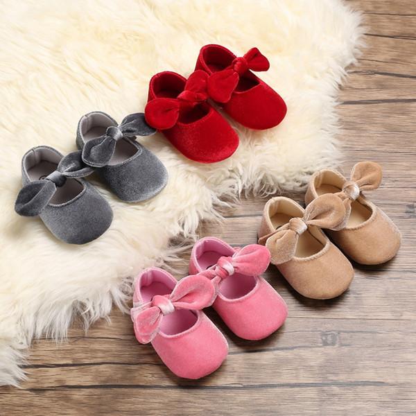Bebek yeni moda ayakkabı yenidoğan bebek kız prenses katı renkler ilk yürüyüşe yumuşak yay kanvas ayakkabılar yüksek kalite