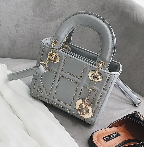 Usine marque femmes sac à main diamant classique tendance sac à main tendance Joker diamant sac à bandoulière en cuir rivet sac Messenger