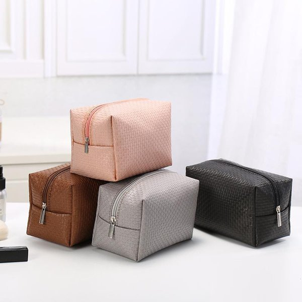 best selling OLOEY Stylish and simple cosmetic bag Unisex wash bag Zipper pouch Woven PU leather free delivery