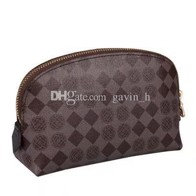Free shipping Top quality Canvas oxidizing Leather cosmetic pouch Famous brand Designer Zippy Toiletry Bag makeup case 47515 47353