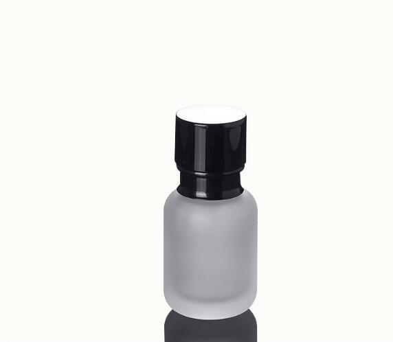 Venta al por mayor caliente 50 ML Frosted Lotion Bottle Negro Presión Negro Cubierta Cosmética Cristal Crema Dividida Botella de viaje