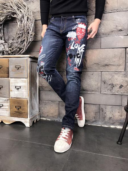 Diseño original de alta calidad Personalidad de los hombres Distressed Slim Jeans Patrón de Graffiti Jeans estampados Vintage Ripped motocicleta Jeans 1860
