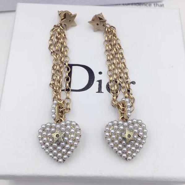 Pendientes de diseño de lujo Joyas para mujeres Accesorios Pendientes de corazón de cobre retro con perla de cristal blanco rojo