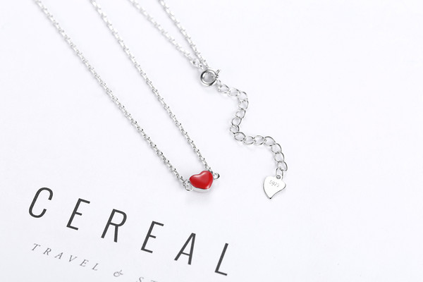 Wholesale Women's Lucky two-sided mahogany creative silver-plated pendant necklace with lady's ten-point chain and heart-shaped tail chain