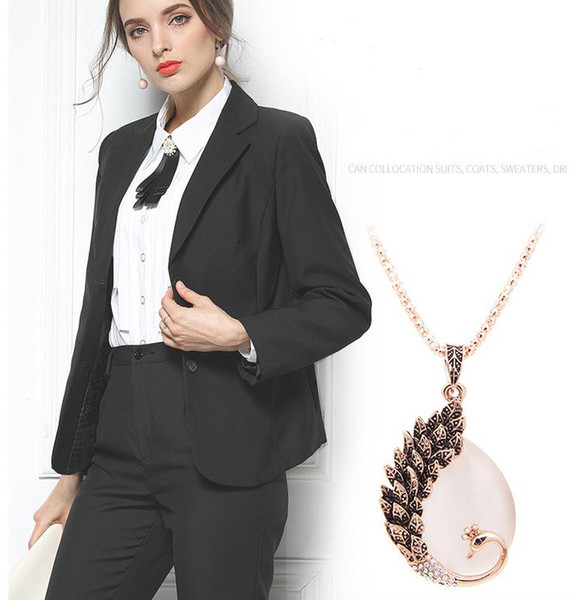 2019 new European and American retro peacock cat's eye pendant long sweater chain female necklace clothing pendant accessories