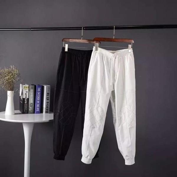Vestido casual mens calças qualidade superior material de algodão não se desvanece símbolo de identidade brilhante wearable high-end calças stretch