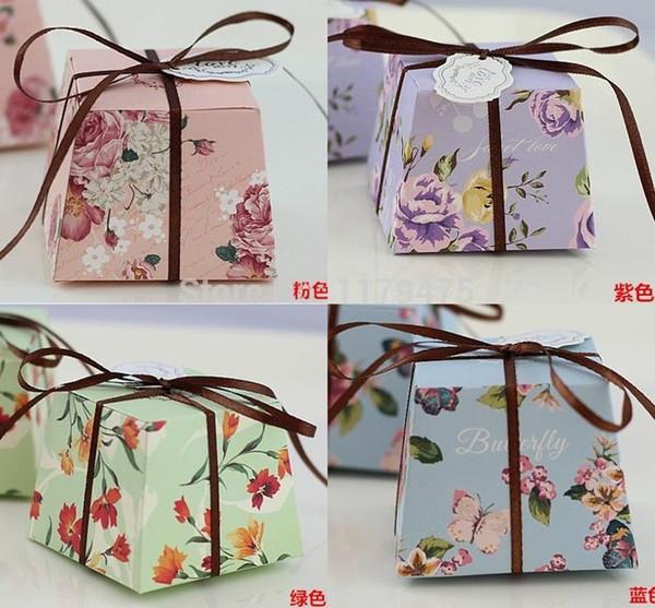 Wholesale-100Pcs Trapezoid verde / viola / blu / rosa floreale stampato fiore Bomboniere Bomboniere Scatole regalo per feste con nastri