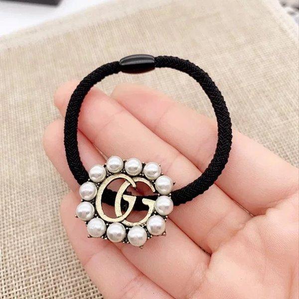 Venta al por mayor nueva llegada rhinestone letras perla pelo bandas de goma pelo elástico famoso accesorio para el cabello regalo de la joyería