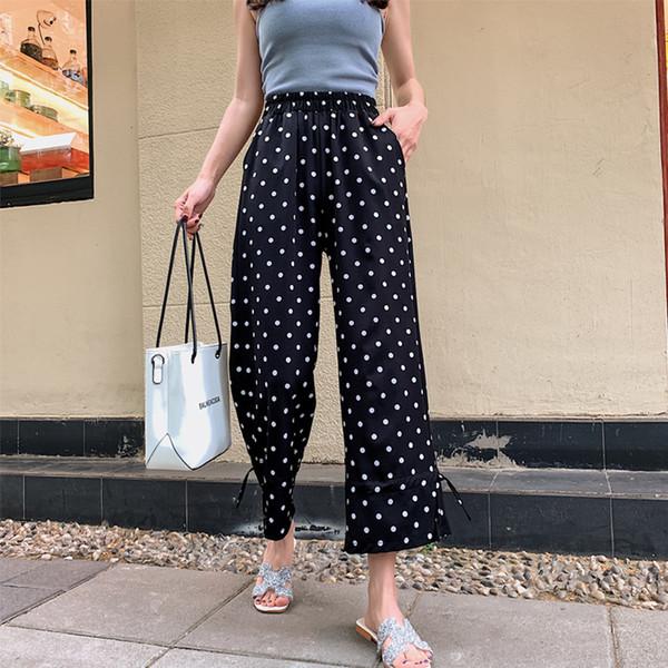 Pantaloni da donna alla moda di marca con motivo a pois neri Pantaloni a vita bassa da donna a vita alta dal design elegante delle donne S-2XL