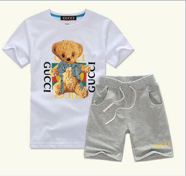 HOT VENDER Nova Moda Vestuário de Luxo Logotipo Designer COCO Meninos E Meninas Terno Dos Esportes Do Bebê Infantil de Manga Curta Roupas Crianças Set 2-7 T