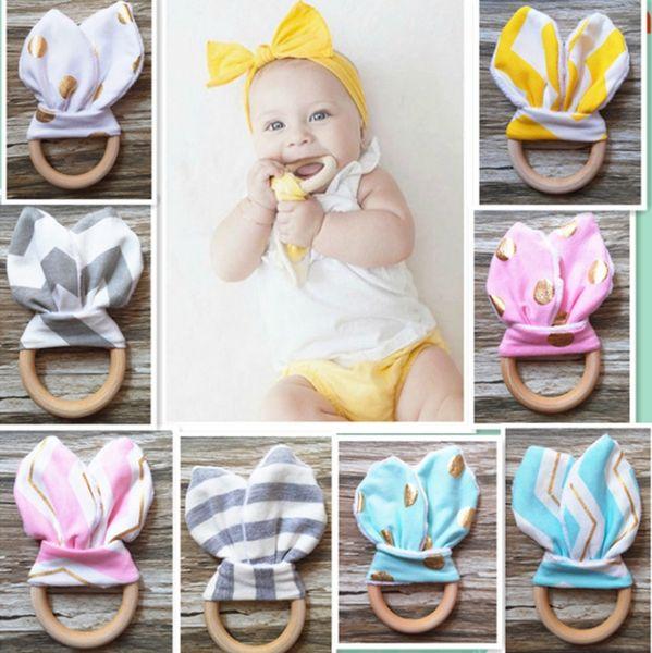 Häschen-Ohr-Beißring-hölzerner Beißring-Baby-Beißspielzeug-Kind kaut Baby-Zahn-Stock-Babypflege-Werkzeuge 30 Entwürfe YW1908
