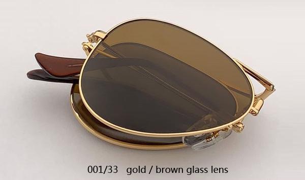 001/33 عدسة زجاجية ذهبية / بنية