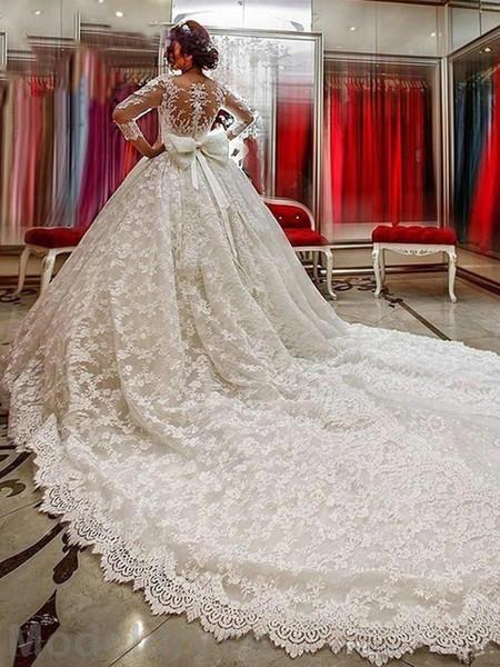 Robes De Mariée En Dentelle De Luxe À Manches Longues Illusion Cou Retour Appliques Arabe Robes De Mariée De Haute Qualité Robe De Mariée Custom Made