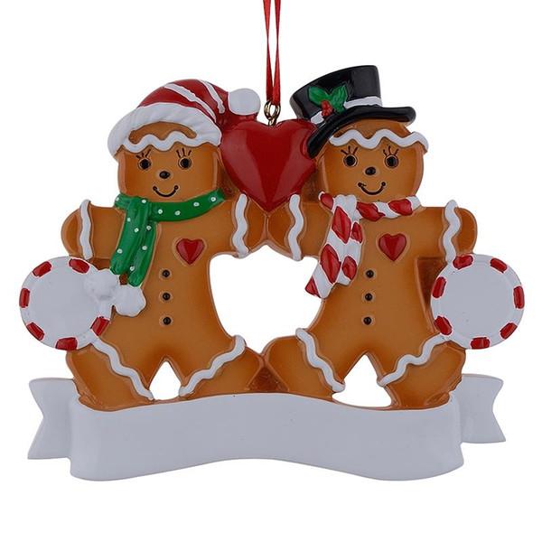 Großhandel Lebkuchen-Familie von 2 Harz Ornamente mit roten Apfel als personalisierte Geschenke für Feiertags-Party Home Decor