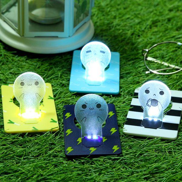 Mini-Portemonnaie Taschen-Kreditkarte Größe bewegliche LED-Nachtlicht-Lampen nette Papierkarten Taschenlampe Lustige Gesichtsausdruck Lampe
