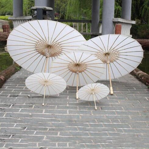 top popular Bridal wedding parasol white paper umbrella Chinese mini craft umbrella 4 diameter: 20, 30, 40, 60cm wedding umbrella wholesale. 2019