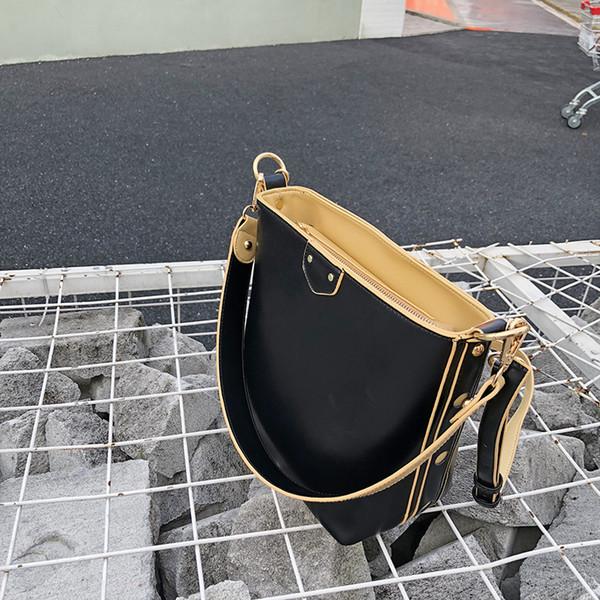 venta al por mayor 2019 de las mujeres del hombro de Corea tendencia de la moda bolsos salvaje bolsas de mensajero de la PU de señora Bucket sólido bolso femenino