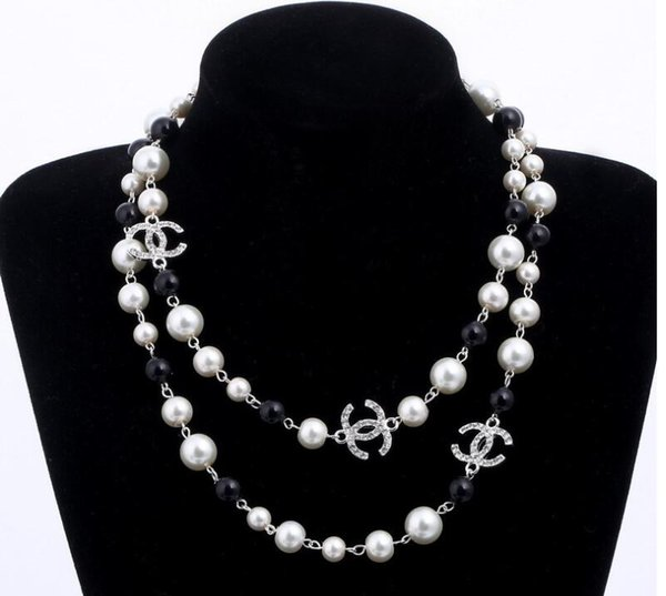 Lange simulierte Perlenkette für Frauen No. 5 Doppelschicht Anhänger lange Halskette Partei Halskette