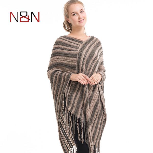 Alta calidad popular mujer chal poncho suéter de punto fino mujeres cálido flojo oblicuo flecos rayas suéteres con cuello en v borla