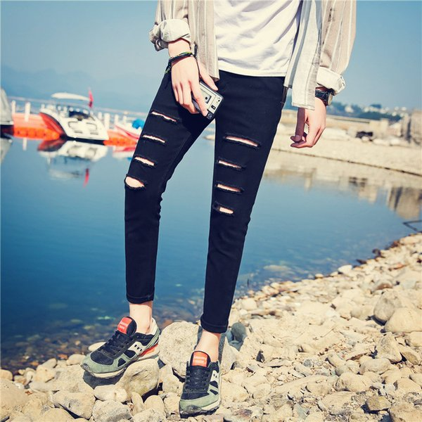 Summer men's jeans, skinny feet, Korean version of the self-repair style, teenagers, nine pants students, male hole pants.
