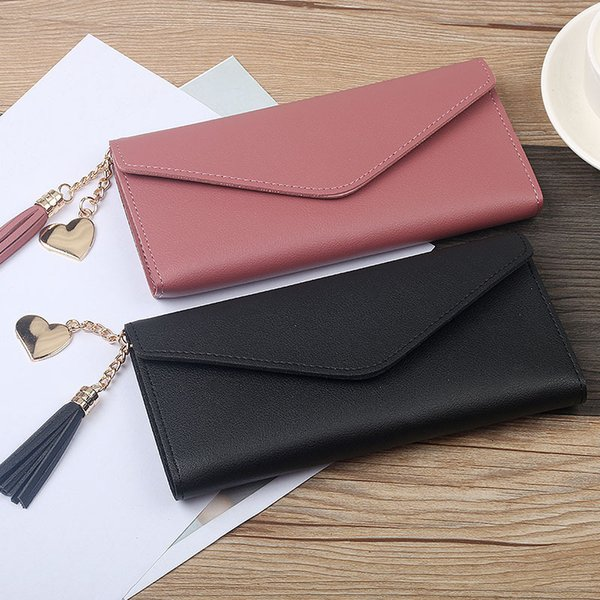 solid color long ladies wallet pu leather buckle wallet heart pendant wild womens wallet fashion tassel female clutch bag