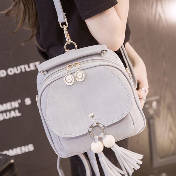 Livraison gratuite, 2019 nouveaux sacs à dos à pampilles, sac à bandoulière fashion version coréenne, sac à bandoulière rétro pour femme, sac tendance pour femme.