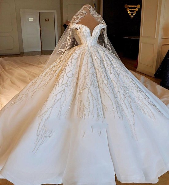 2019 Luxury Dubai Ball Gown Wedding Dresses Off Shoulder Lace Beaded Sequins Cap Sleeves Puffy Chapel Train Plus Size Formal Bridal Gowns
