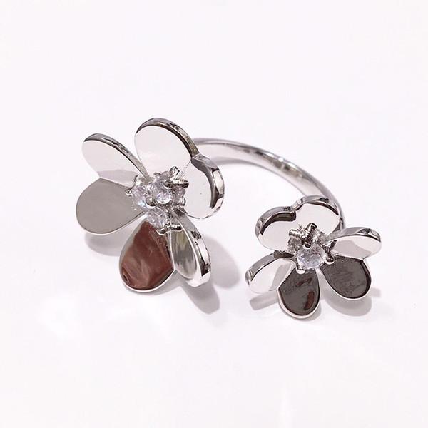 ingrosso moda di alta qualità doppio fiore color argento con zirconi in centro aperto anello in acciaio inox per le donne