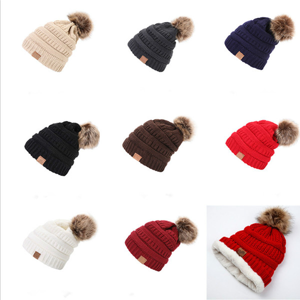 top popular Unisex Trendy Hats Winter Knitted Fur Poms Beanie Label Fedora Luxury Cable Slouchy Skull Caps Fashion Leisure Beanie Christmas Gifts DHL 2019