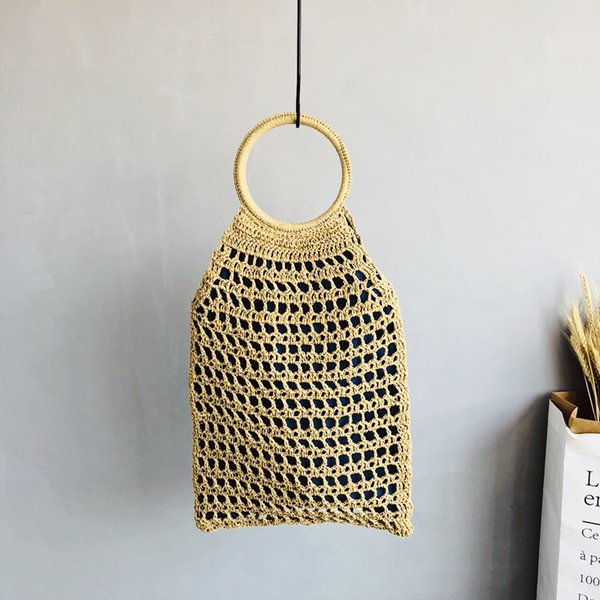 2019 personalized hollow net bag hand-woven bag ring rattan portable female summer new ins net straw