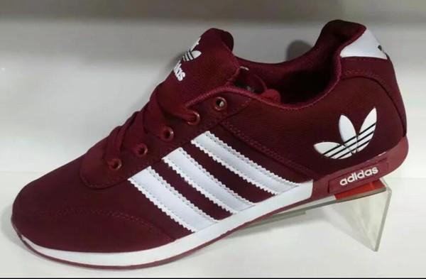 Klasik marka tasarım erkek spor ayakkabıları erkekler ve kadınlar gençlik gündelik spor ayakkabı moda çift modelleri