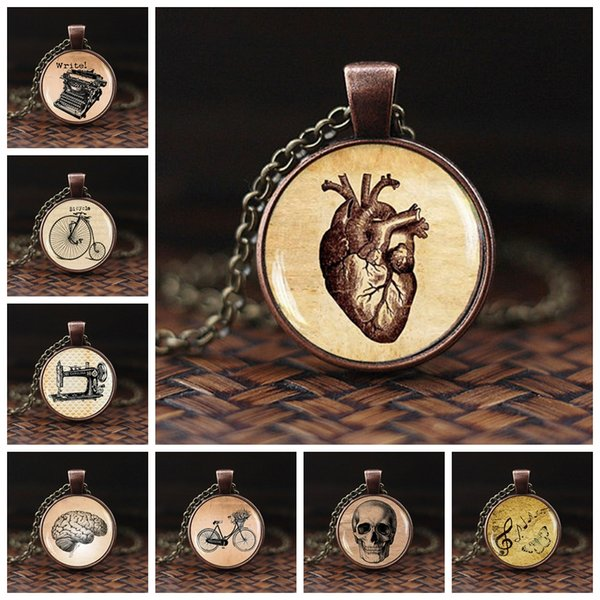 Collana cuore anatomico Gioielli vintage Anatomia Cuore Cupola in vetro Cabochon Collana lunga in bronzo con pendente a catena Donna