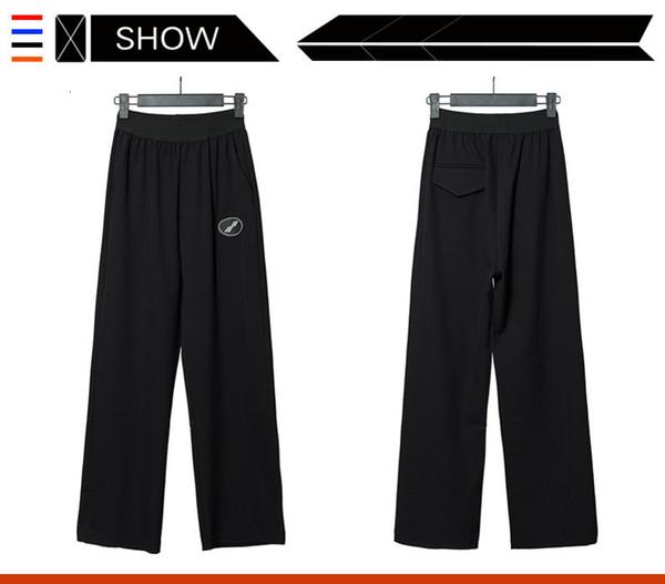 Hombres y mujeres Pantalones de marea de moda y original diseño Sweatpants cómodo Aflojar los pantalones Confort