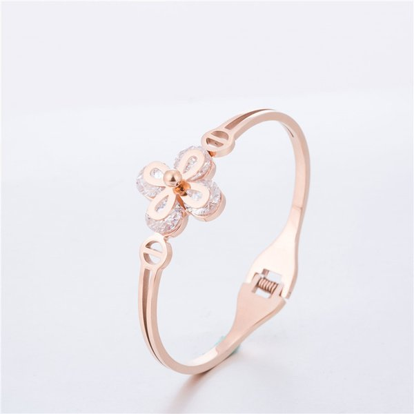 Circón femenino de cuatro hojas pulsera de flor de acero de titanio de oro rosa de oro apertura de gama alta pulsera joyería al por mayor