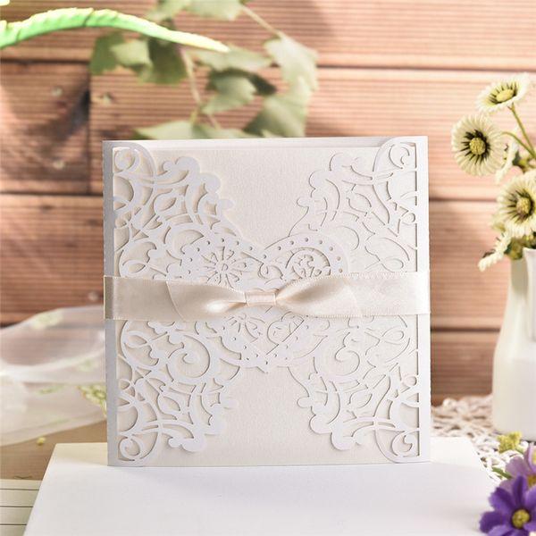 10pcs / lot Tarjeta de Invitación de la casilla blanca elegante de la invitación de boda del cordón delicado tallado Tarjetas con Bowknots para Servicios de boda