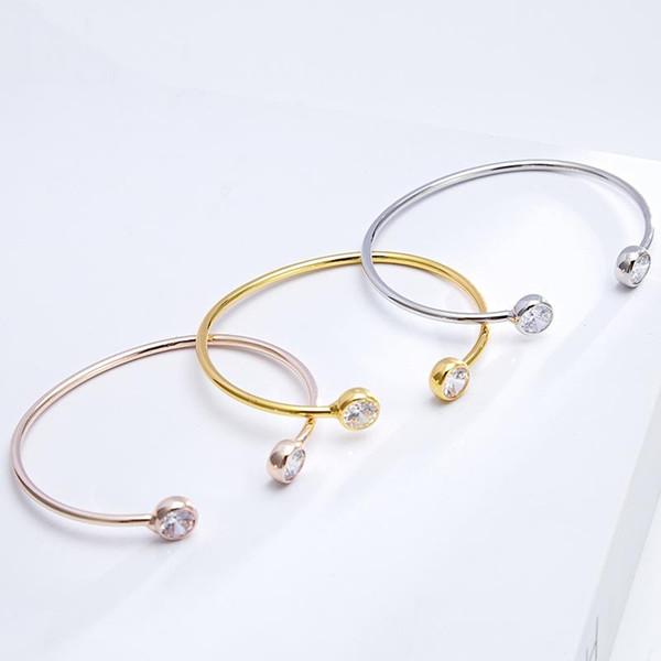 Nueva aleación de diamantes simple pulsera abierta pulsera de circonio rosa joyería de oro