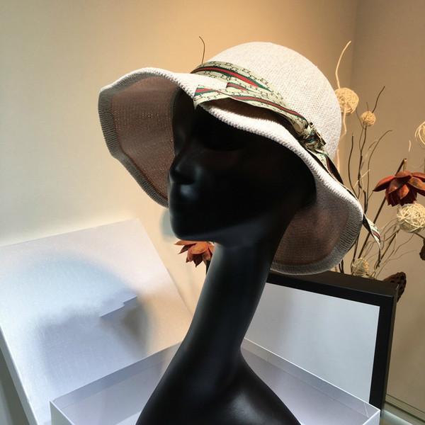 Primavera y verano nuevo retro dorado trenzado cabeza plana paja Sombrero de diseñador de lujo señora aleros anchos protector solar sombrero para el sol sombrero de verano smart_k